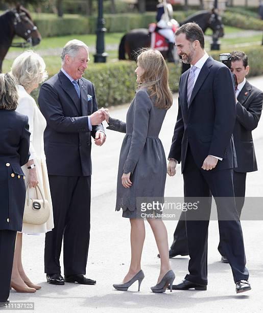 Camilla Duchess of Cornwall Prince Charles Prince of Wales greet Princess Letizia Princess of Asturias and Prince Felipe Prince of Asturias at the...