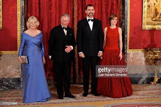 Camilla Duchess of Cornwall Prince Charles Prince of Wales greet Princess Letizia Princess of Asturias and Prince Felipe Prince of Asturias as they...