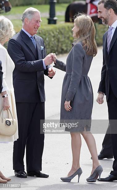 Camilla Duchess of Cornwall Prince Charles Prince of Wales greets Princess Letizia Princess of Asturias and Prince Felipe Prince of Asturias at the...