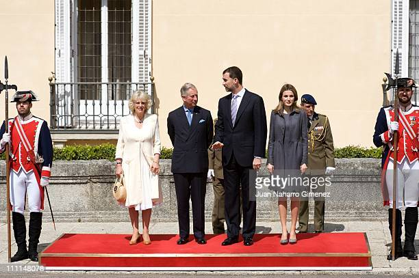 Camilla Duchess of Cornwall Prince Charles Prince of Wales Prince Felipe of Spain and Princess Letizia of Spain pose together at the Palacio Del...