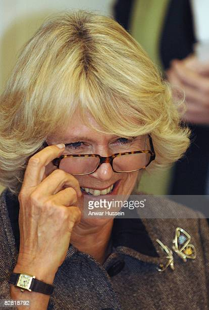 Camilla, Duchess of Cornwall puts on her reading glasses to try her hand at calligraphy during a visit to the Pound Arts Centre on October 26, 2007...