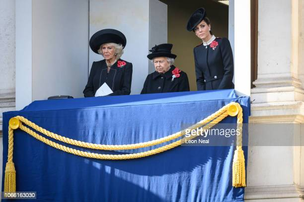 Camilla Duchess of Cornwall Queen Elizabeth II and Catherine Duchess of Cambridge watch from a balcony of the Foreign and Commonwealth Office during...
