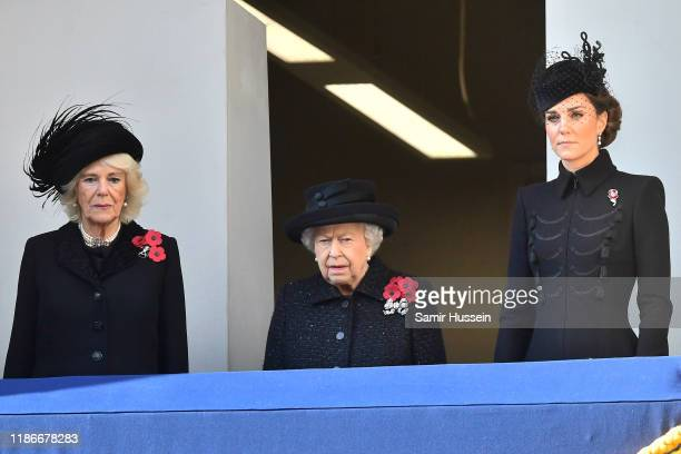 Camilla Duchess of Cornwall Queen Elizabeth II and Catherine Duchess of Cambridge attend the annual Remembrance Sunday memorial at The Cenotaph on...