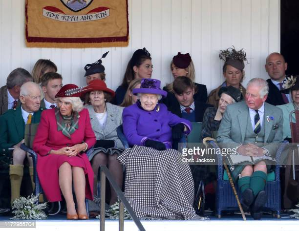Camilla Duchess of Cornwall Queen Elizabeth II Prince Charles and Prince of Wales watch the 2019 Braemar Highland Games at The Princess Royal and...