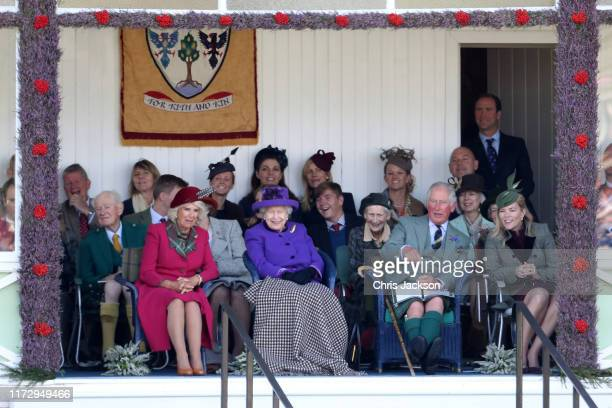 Camilla Duchess of Cornwall Queen Elizabeth II Prince Charles Prince of Wales and Autumn Phillips watch the 2019 Braemar Highland Games at The...