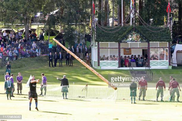 Camilla Duchess of Cornwall Queen Elizabeth II Prince Charles Prince of Wales Autumn Phillips and Peter Phillips watch the caber toss from the Royal...
