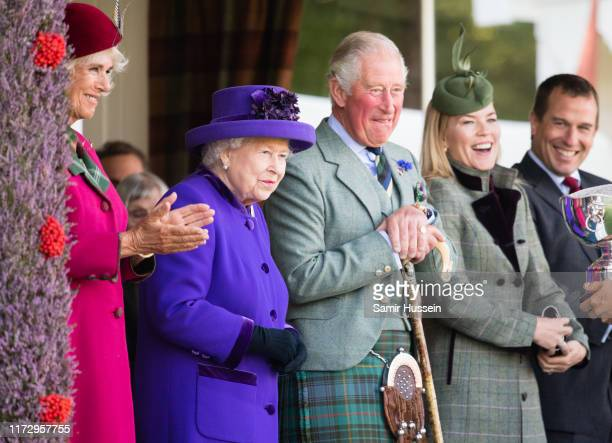 Camilla Duchess of Cornwall Queen Elizabeth II Prince Charles Prince of Wales Autumn Phillips and Peter Phillips attend the 2019 Braemar Highland...