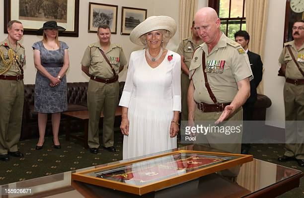 Camilla Duchess of Cornwall receives a gift following a guard of honour parade by the Royal Australian Corps of Military Police after being appointed...