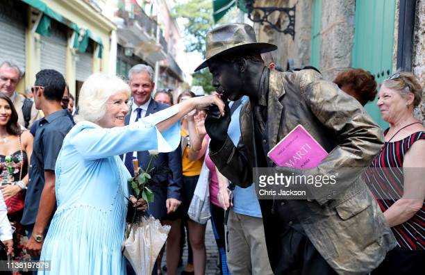 Camilla Duchess of Cornwall receives a kiss on her hand during a guided tour of Old Havana on March 25 2019 in Havana Cuba Their Royal Highnesses...