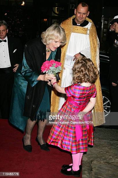 HRH Camilla Duchess of Cornwall receives a posy of flowers from Emelia Jones daughter of singer and TV presenter Aled Jones as she arrives for the...
