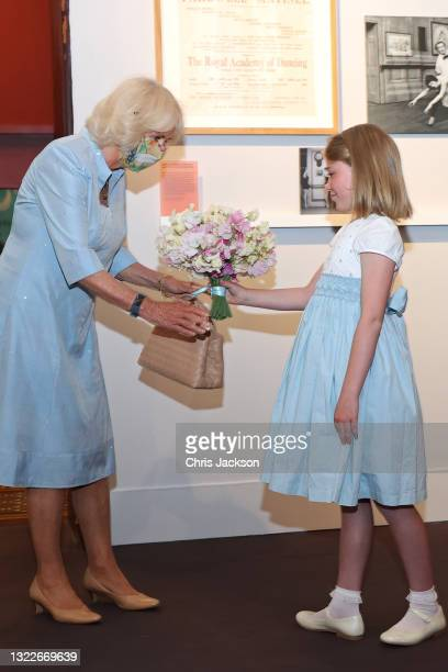 Camilla, Duchess of Cornwall recives a bunch of flowers from RAD student, Ottilie McKinley at The V&A on June 09, 2021 in London, England. 'On Point:...