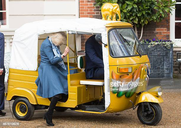 Camilla Duchess of Cornwall rides in a rickshaw as they launch 'Travels to my Elephant' Rickshaw Race at Clarence House on March 26 2015 in London...