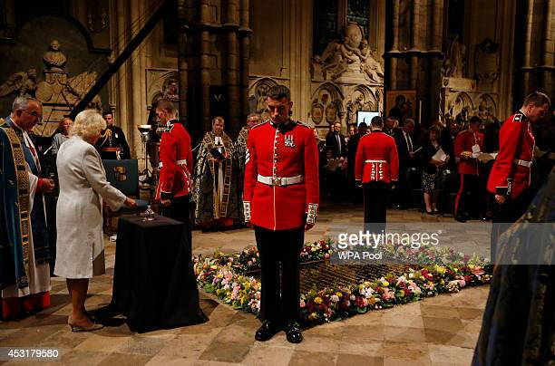 Camilla, Duchess of Cornwall, second left, extinguishes the remaining flame at the Grave of the Unknown Warrior during a candlelit vigil and prayer...