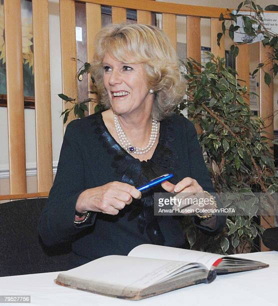 Camilla Duchess of Cornwall signs the visitors book at the Royal National Hospital for Rheumatic Diseases February 5 2008 in Bath England