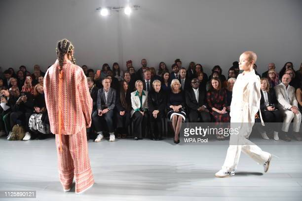 Camilla Duchess Of Cornwall sits next to editorinchief of British Vogue magazine Edward Enninful during the Bethany Williams Show as she visits...