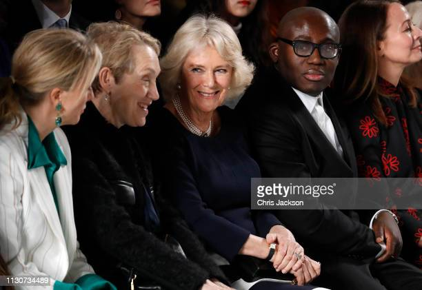 Camilla, Duchess Of Cornwall sits next to editor-in-chief of British Vogue magazine Edward Enninful during the Bethany Williams Show as she visits...