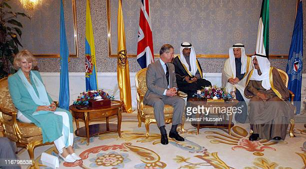 Camilla Duchess of Cornwall sits on a golden seat while Prince Charles Prince of Wales talks to the Emir of Kuwait Sheikh Sabah AlSabah at his Palace...
