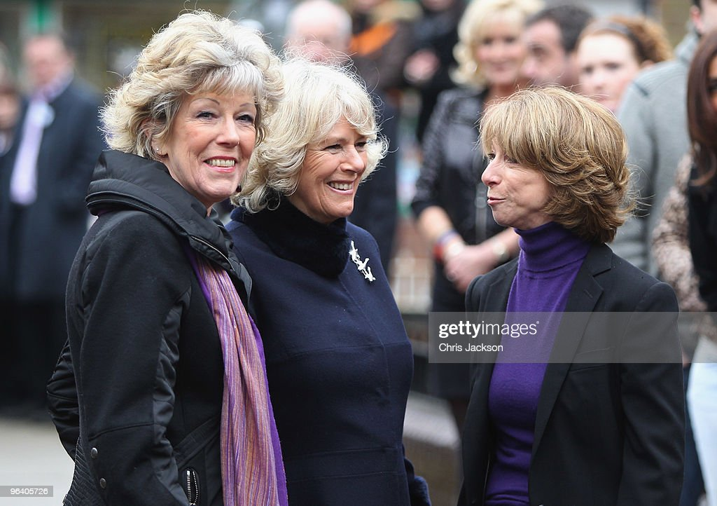 Camilla, Duchess of Cornwall smiles as she chats to cast members Helen Worth and Sue Nicholls during a tour of the Coronation Street set on February 4, 2010 in Manchester, England.