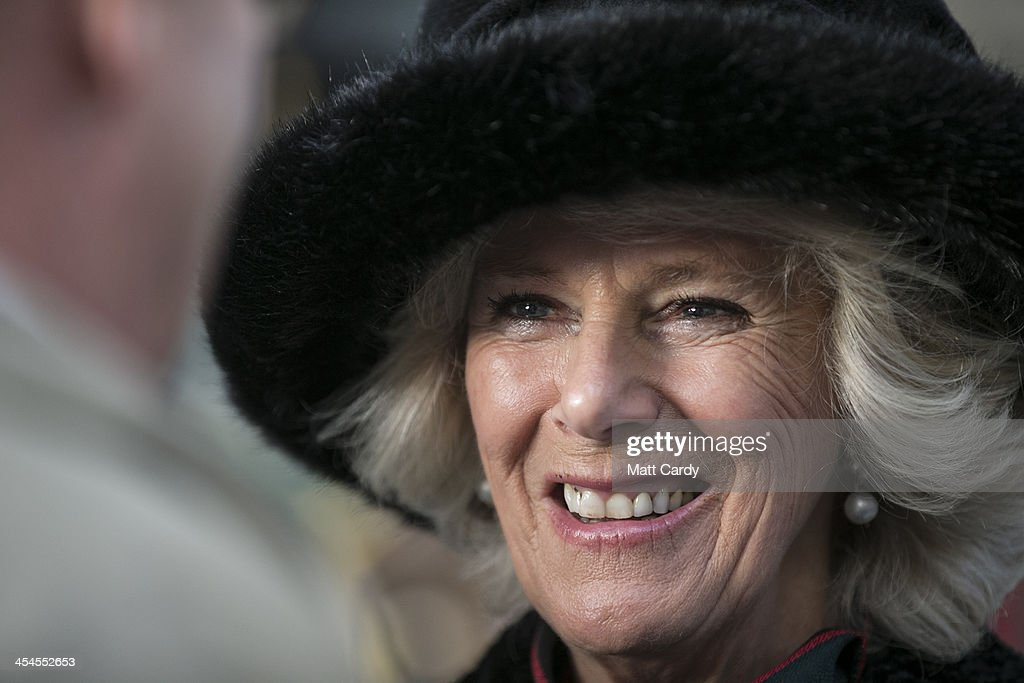 Camilla, Duchess of Cornwall smiles as she meets soldiers families as she welcome home the 4th Battalion The Rifles and presents medals on their return from Afghanistan at their barracks in Bulford on December 9, 2013 in Wiltshire, England.