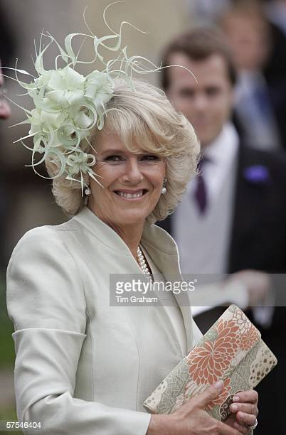 Camilla Duchess of Cornwall smiles at the wedding of her daughter Laura ParkerBowles to Harry Lopes at St CyriacOs Church Lacock on May 6 2006 in...