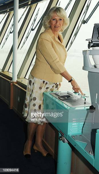 Camilla, Duchess Of Cornwall sounds the noon whistle on board the Cunard Liner 'Queen Victoria while on her visit to Merseyside on July 26th in...