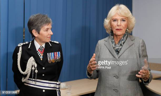 Camilla Duchess of Cornwall speaks as Metropolitan Police Commissioner Cressida Dick looks on as she visits the Metropolitan Police Service Base to...
