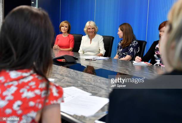 Camilla Duchess of Cornwall speaks members of the 5 News team including journalist Sian Williams as she visits the headquarters of Independent...