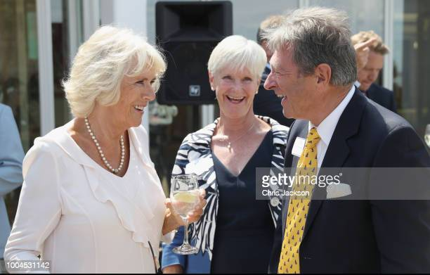 Camilla Duchess of Cornwall speaks to Alan Titchmarsh and his wife Alison Titchmarsh as she attends a reception at the Royal Yacht Squadron on July...