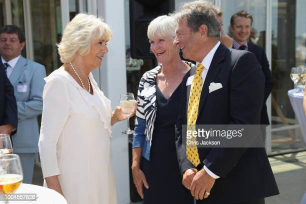 Camilla Duchess of Cornwall speaks to Alan Titchmarsh as she attends a reception at the Royal Yacht Squadron on July 24 2018 in Cowes Isle of Wight...