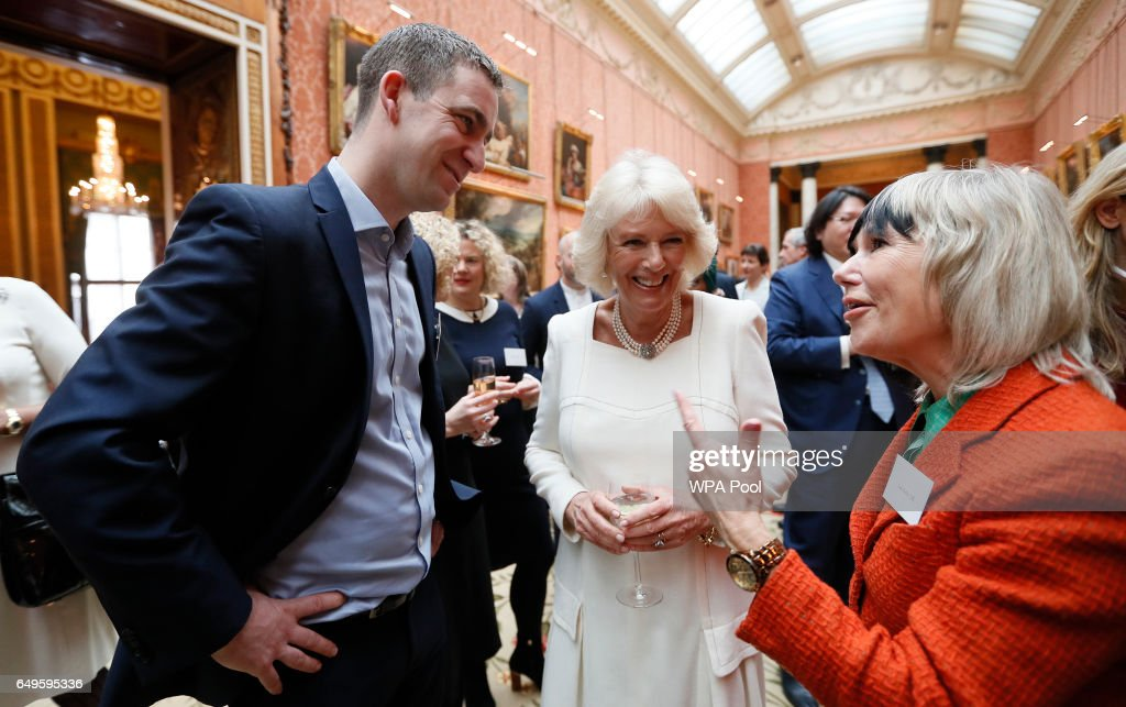 Camilla, Duchess of Cornwall speaks to Brendan Cox, left, and Jude Kelly, right, as she hosts a Women of the World reception at Buckingham Palace on March 8, 2017 in London, England.