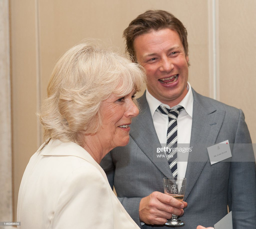 Camilla, Duchess of Cornwall speaks to chef Jamie Oliver at a reception at Buckingham Palace on June 15, 21012 in London, England. Queen Elizabeth II and the Duchess of Cornwall met winners of the 'Cook for the Queen' competition, who created the menu served at a reception at Buckingham Palace.