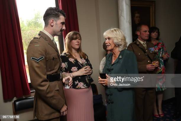 Camilla Duchess of Cornwall speaks to Corporal Jack Stock during a visit to New Normandy Barracks on July 12 2018 in Aldershot England