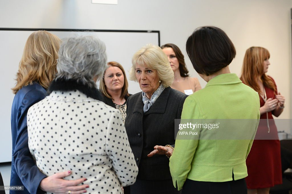 Camilla, Duchess of Cornwall speaks to Diana Parkes (polka dot) at Safelives Centre on January 27, 2016 in London, England.