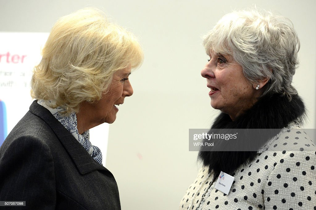 Camilla, Duchess of Cornwall speaks to Diana Parkes whose daughter Joanna Brown was killed by her husband Robert at Safelives Centre on January 27, 2016 in London, England.