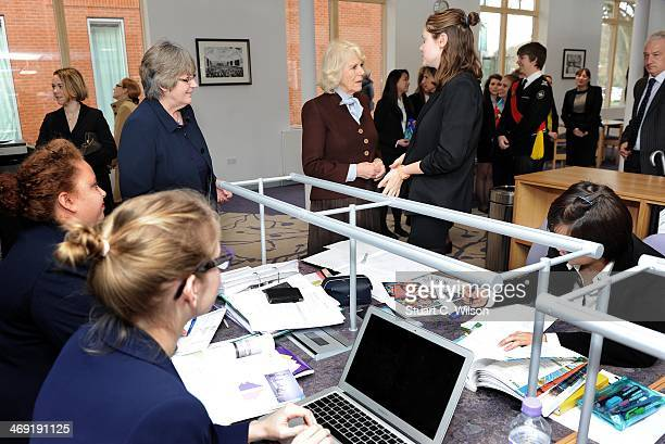 Camilla Duchess Of Cornwall speaks to girls as he visits St Catherine's School in Bramley Surrey on February 13 2014 in Guildford England