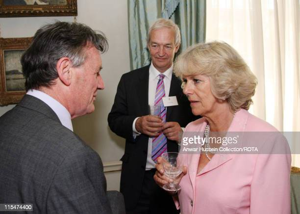 HRH Camilla Duchess of Cornwall speaks to Michael Palin and Jon Snow during a reception for the Royal Television Society at Clarence House in London...