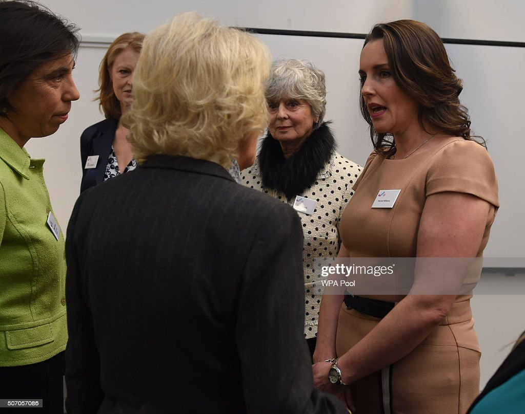 Camilla, Duchess of Cornwall speaks to Rachel Williams (brown dress) and Diana Parkes (polka dot) at Safelives Centre on January 27, 2016 in London, England.