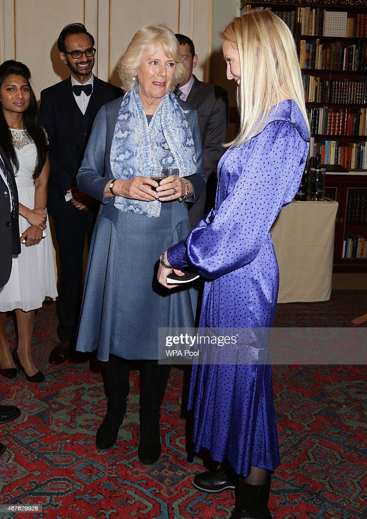 Camilla, Duchess of Cornwall speaks to Ruth Powys, Chief Executive, Elephant Family, during a reception to launch 'Travels To My Elephant' at Clarence House on March 26, 2015 in London, England. In November 2015 a fleet of thirty rickshaws will journey 500km across Madhya Pradesh, India, in a race to save Asias elephants from extinction.