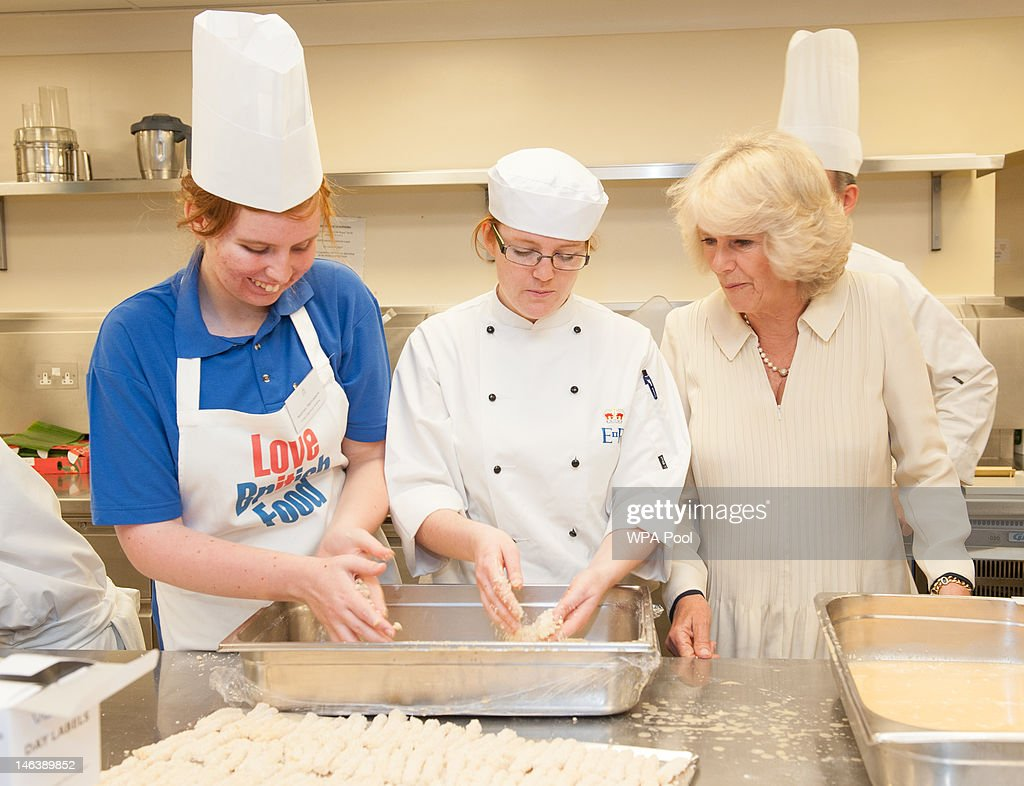 Camilla, Duchess of Cornwall speaks to Sequoia Trevorrow (L) a pupil at Cape Cornwall School and chef Gemma Powell in the kitchens of Buckingham Palace on June 15, 21012 in London, England. Queen Elizabeth II and the Duchess of Cornwall met winners of the 'Cook for the Queen' competition, who created the menu served at a reception at Buckingham Palace.