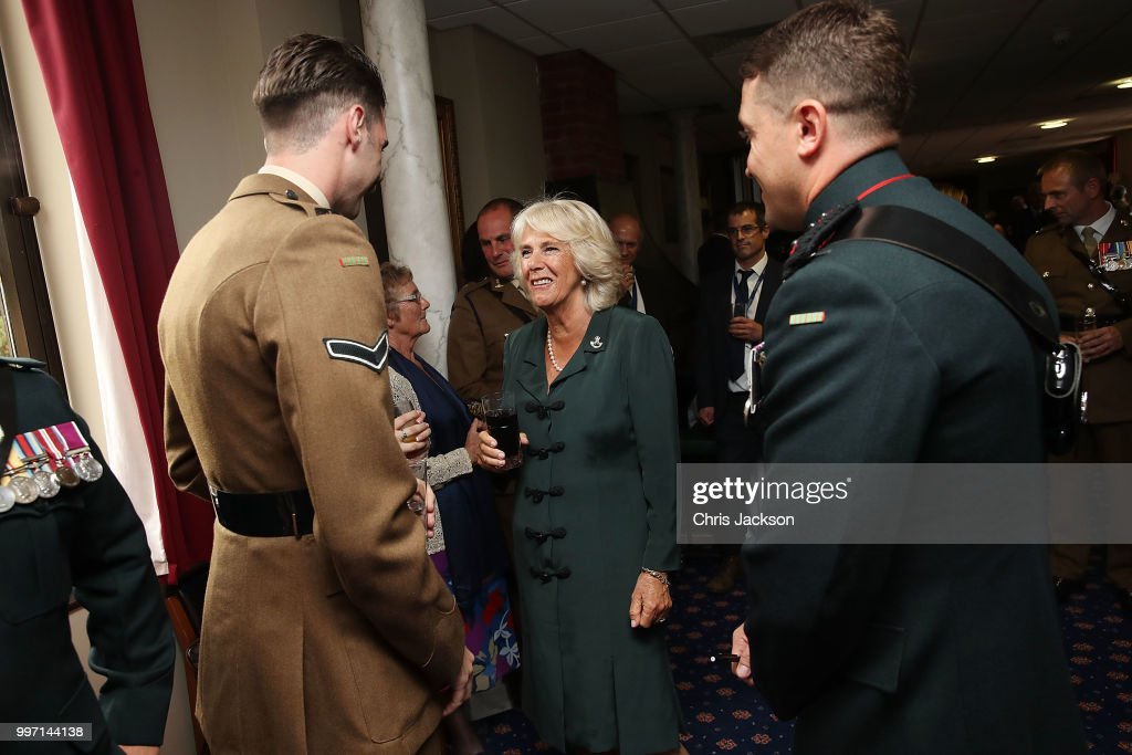 Camilla, Duchess of Cornwall speaks to soldiers during a visit to New Normandy Barracks on July 12, 2018 in Aldershot, England.