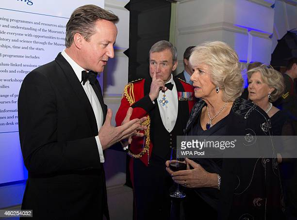 Camilla, Duchess of Cornwall speaks with British Prime Minister David Cameron as Chief of Defence Staff Sir Nick Houghton looks on at A Night of...