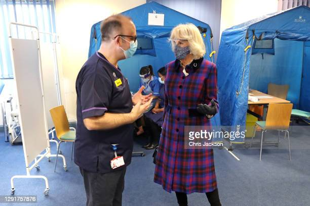Camilla, Duchess of Cornwall speaks with Director of quality and chief nurse, Professor Steve Hams during a visit to Gloucestershire Vaccination...