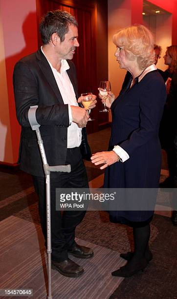 Camilla Duchess of Cornwall speaks with journalist Paul Conroy who was with the late Marie Colvin in Syria as she attends A Hard CallingReporting...