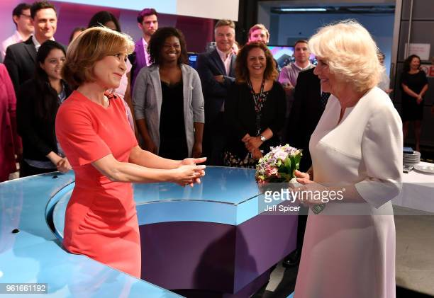 Camilla Duchess of Cornwall speaks with journalist Sian Williams as she visits the headquarters of Independent Television News Ltd to mark the 21st...