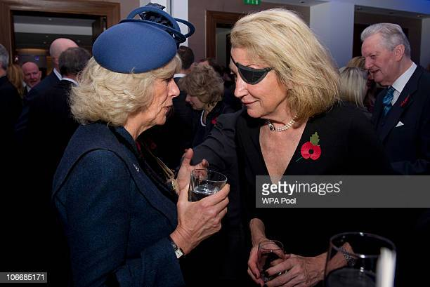 Camilla Duchess of Cornwall speaks with Marie Colvin of The Sunday Times during a service at St Bride's Church November 10 2010 in London England The...