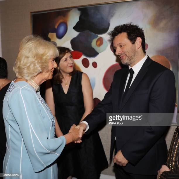camilla-duchess-of-cornwall-speaks-with-michael-sheen-as-she-attends-picture-id958547824