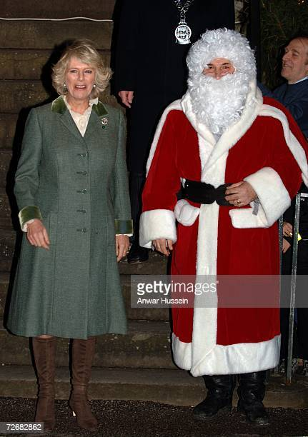 Camilla Duchess of Cornwall stands with Father Christmas as she turns on the Christmas lights on November 30 2006 in Tetbury England