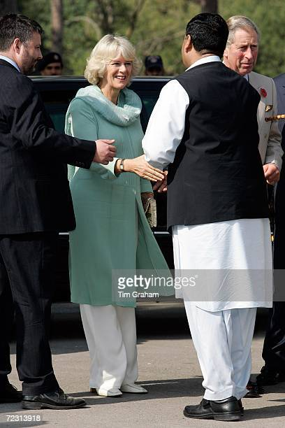 Camilla Duchess of Cornwall surrounded by security wears a traditional shalwar kameez in turquoise to visit the all female Fatima Jinnah University...
