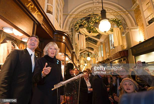 Camilla Duchess of Cornwall switches on the Burlington Arcade Christmas Lights where she meets with shopkeepers and guests on November 23 2011 in...