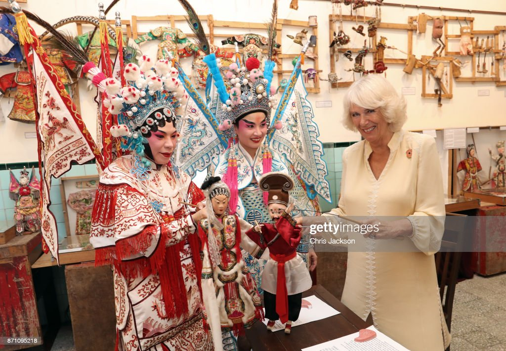 Camilla, Duchess of Cornwall takes part in a traditional puppet show at the Teochew Puppet & Opera House in George Town, Penang, Malaysia. Prince of Wales and Camilla, Duchess of Cornwall are on a tour of Singapore, Malaysia, Brunei and India.